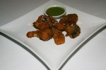 Vegetable Pakoras - Cauliflower, potato, eggplant and onions crisp fried in spiced chick pea batter
