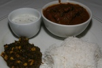 Lamb Bhuna gosht - Lamb in a sauce seasoned with roasted spices and onions Served with saagcorn, rice, naan and raita