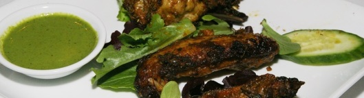 Tandoori Wings - Marinated in ginger, garlic, lemon juice and exotic spices, cooked over charcoal