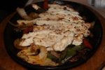 Grilled Chicken Fajita - Seasoned and charbroiled breast with tomato lettuce cheese salsa sour cream ($18.99)