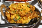 Aloo Gobi - cauliflower and potatoes tempered with crushed ginger, turmeric and cumin