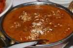 Lamb Korma - lamb cooked in spices braised in a sauce flavoured with almonds and cinnamon