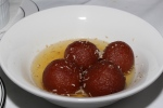 Gulab Jamun - dumplings cooked in light syrup with saffron & pistachios
