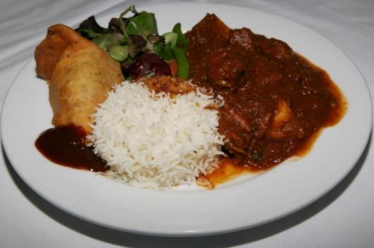Lamb Vindaloo Boneless lamb in a Goan style pickle curry, hot & sour combination, select Goan spices $11.95 (1758)