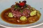 Tuna tartare with ponzu dressing, tobikko, preserved lemon, avocado purée and crispy garlic