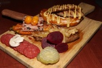 Butchery Board: Pretzle, bratwurst, pickled merguez, rabbit terrine, bison salami