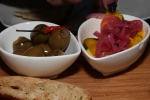 Marinated warm olives, rosemary, olive oil, chilies & garlic; House made pickles; House made crostini