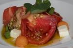 Heirloom Tomato Salad - Monforte feta musk melon sorbet nasturtium white balsamic pumpkin seed gremolata