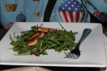 Hallum salad - seared Hallum cheese on a bed of baby arugula in a pomegranate dressing (vegetarian)