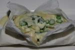 Tortelli Stuffed with Monforte's Ricotta & Peas, Zucchini & Fonduta of Fava in Cartoccio