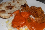 Garlic Naan, Jewelled Basmati, Butter Chicken, and Aloo Gobhi