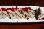 27. Dragon Roll - shrimp tempura unagi avocado tobikko topped sweet barbaeque sauce $12.00