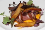 Seared duck breast. oyster mushrooms, sweet potatoes, pattypan squash, sprouts