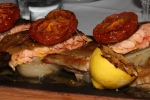 Two whole pan seared, deboned rainbow trout, braised fennel, oven roasted tomatoes, charred lemon
