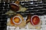 hey mackerella - mackerel fillet on a puffed chip of yuzu juice, chicharonnes, shallot, tomato