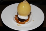 dino egg - passion fruit egg with chocolate and olive oil cake, persimmon, tonka bean meringue, and banana crumble