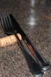 Table service (note the wine bottle cork fork rest)