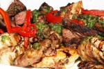 Holiday Platter roasted chicken with Peruvian pepper sauce, grilled flank steak with chimichurri sauce