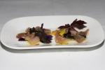 Amuse Bouche - Hamachi with black trumpets, shaved Burgundy black truffle