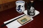 Hot tea, soy sauce and chopsticks