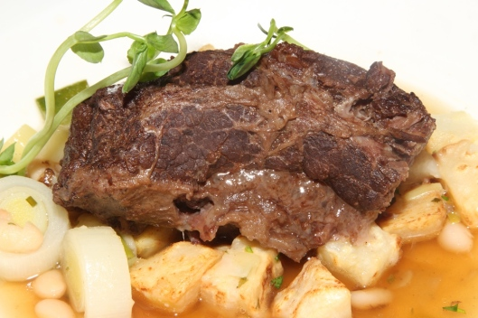 Pot-au-feu braised beef cheek, mirepoix of vegetables, lingot beans, fresh herbs, beef consommé