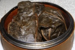 #8 Sticky rice filled with assorted meats and conpoy wrapped and steamed in lotus leaf L $3.00