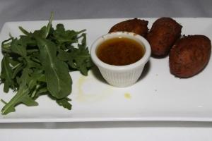 Accras de Morue, sauce Chien - Caribbean style cod fritters, onion, parsley & citrus sauce $10,00