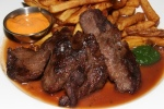 Steak frites, 6 oz. PEI grass-fed flat iron, red wine jus, spicy watercress purée, house-cut fries 23¾