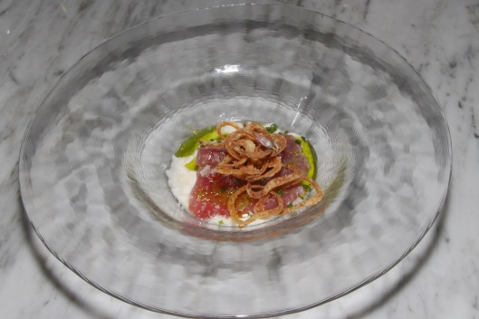 Nova Scotia yellowfin tuna, crème fraîche, crispy shallots, macadamia nuts, green onions