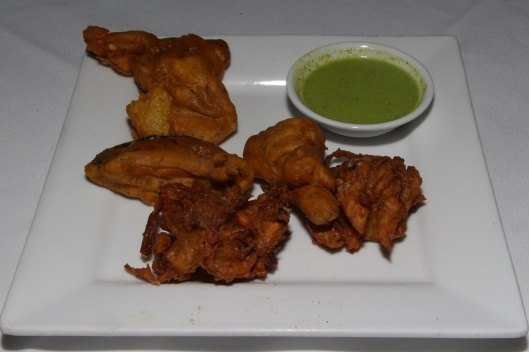 Vegetable Pakoras - cauliflower, potato, eggplant and onions; crisp fried in spiced chick pea batter