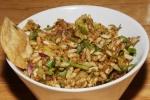 Bhel Puri - savoury combination of puris, puffed rice, sev, onions, potatoes, raw mango and chutneys