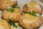 Crispy puris - (mild) stuffed with potatoes, moong daal, smooth yogurt homemade chutneys sev dry spices