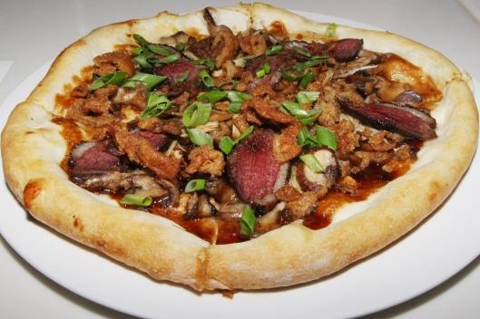 Fusion Confusion • Peking Duck Pizza - Roasted Duck Breast, Enoki & Shitaki Mushrooms, Fresh Mozzarella, Hoisin Drizzle With Green Onions, Crispy Duck Crackling