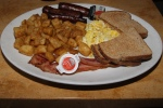 The Big Breakfast: 2 eggs, 2 slices of bacon, 2 sausages, 2 pancakes, home fries and toast $13.99