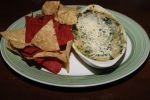 Four cheese spinach dip - A creamy dip served hot with a blend of four cheeses, spinach, artichoke and red peppers. Served with fresh tortilla chips for dipping. $7.99 (Complimentary free appetizer)