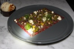 aged wagyu - beef fat vinaigrette, onion tops, pea relish, coffee $16