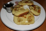 Buttermilk pancakes with bananas, whipped butter, real maple syrup $8.50 peameal bacon $5.00