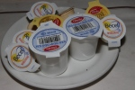 Baked potato condiments - sour cream, butter and margarine