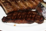 Steak and Ribs - 8 oz. New York Steak and Our Famous Ribs $40.25