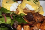 Peameal bacon (or smoked trout) benedict: two poached eggs and hollandaise on an English muffin served with house potatoes and mixed greens $16