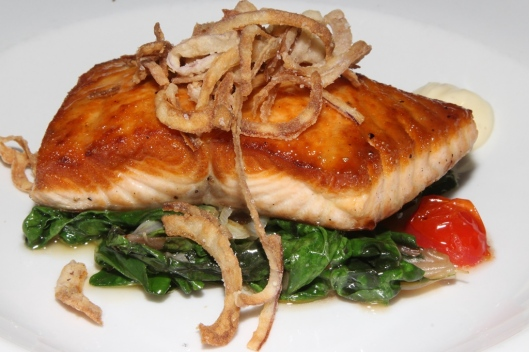 Atlantic salmon honey dijon glaze, wilted Swiss chard, cherry tomato, crisp onion, butter sauce $20