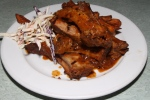 the original ribs, baby back pork ribs with slow stewed BBQ sauce and yam fries $25